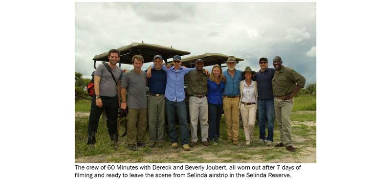 The crew of 60 Minutes with Dereck and Beverly Joubert.